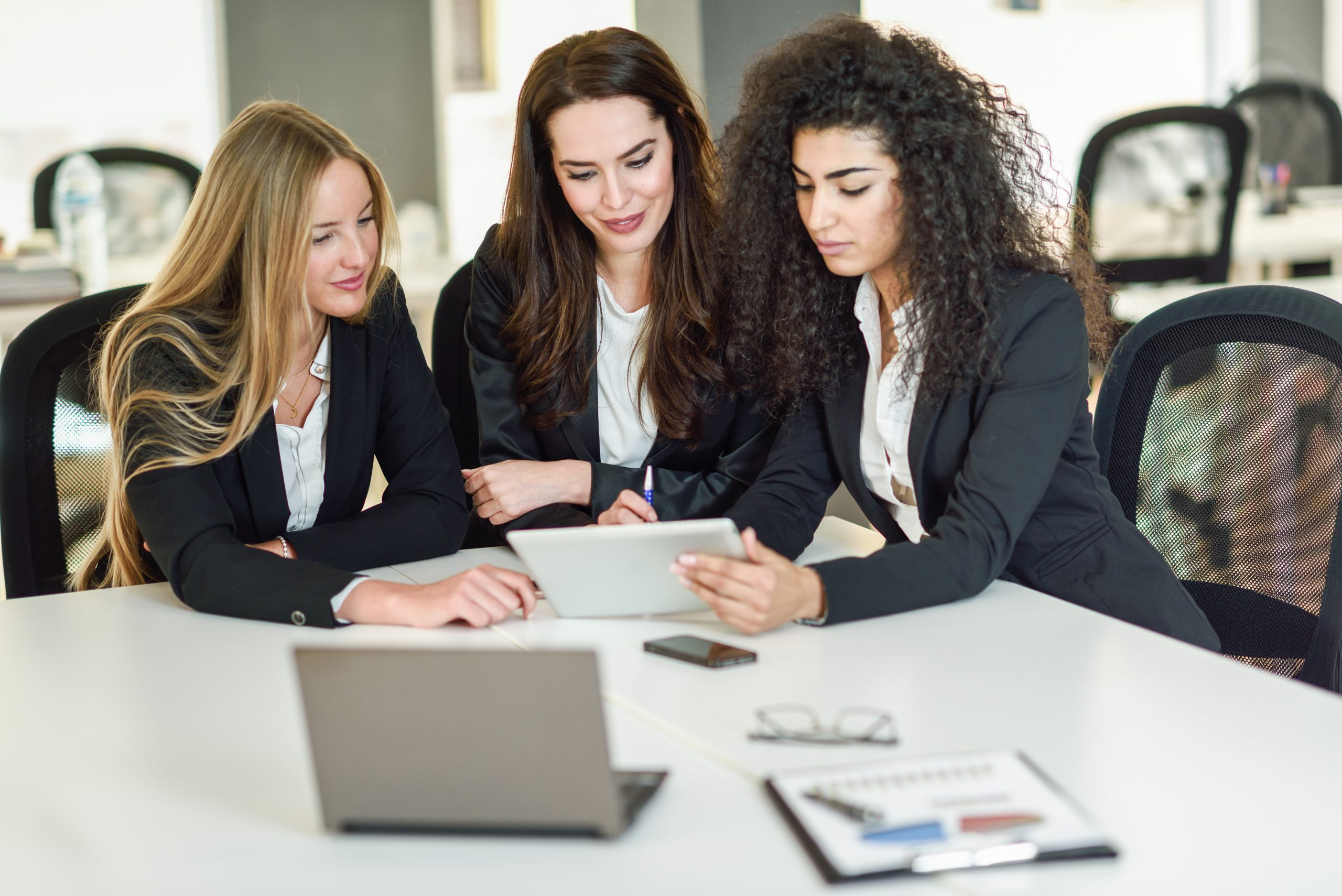 Three Business women working together with requirements for business
