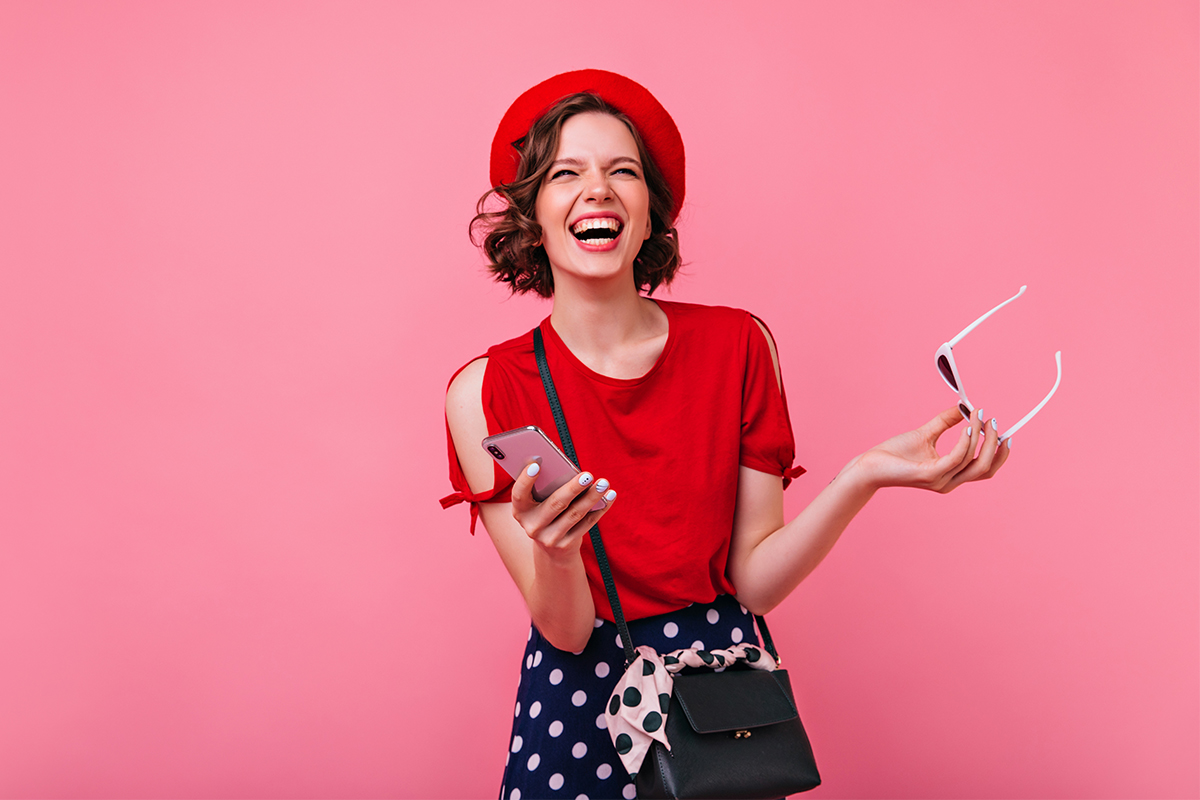 Female model with phone hand smiling