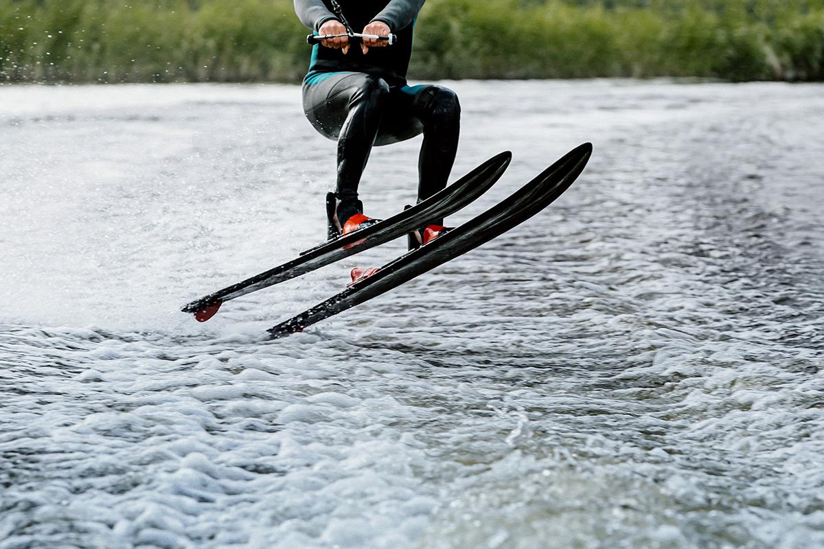 Man waterskiing on lake behind