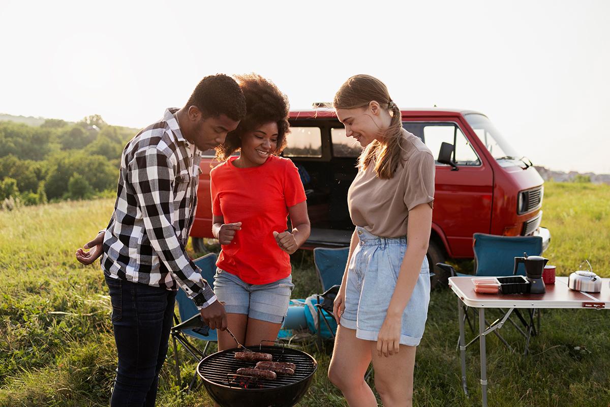 Medium shot friends preparing barbecue
